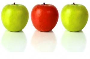 This is an image of three apples - two green and one red - titled positioning and why it's different
